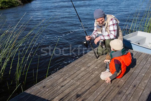 Happy man fishing with his son Stock photo © wavebreak_media