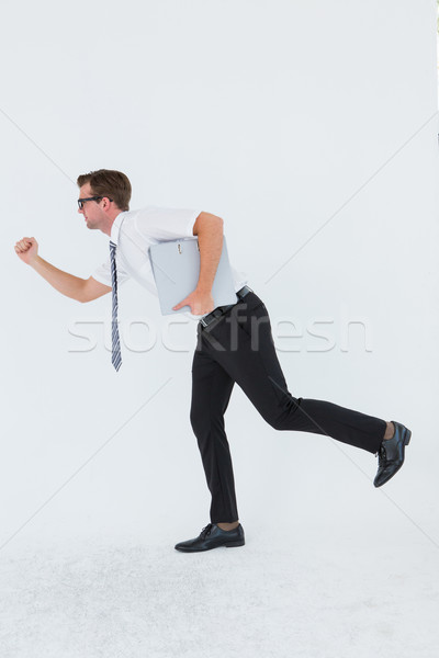 Geeky businessman running late Stock photo © wavebreak_media