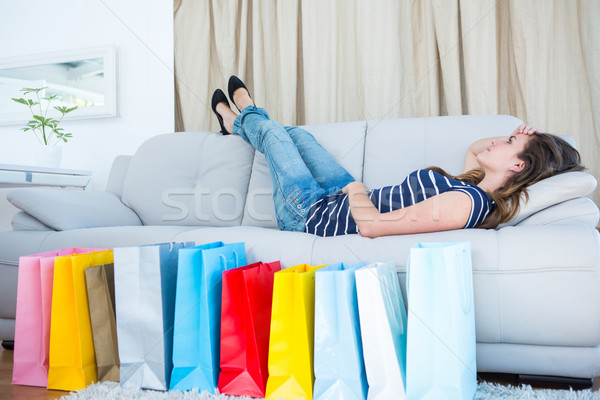 Stockfoto: Mooie · vrouw · bank · woonkamer · home · jeans