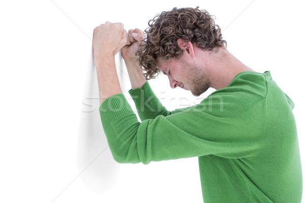 Sad casual man leaning against wall Stock photo © wavebreak_media