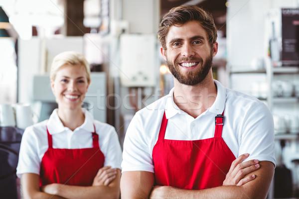 Two baristas smiling at the camera Stock photo © wavebreak_media