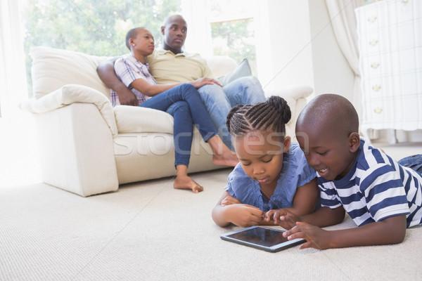 Happy siblings using digital tablet  Stock photo © wavebreak_media
