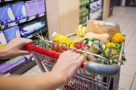 Close up view of woman pushing trolley Stock photo © wavebreak_media