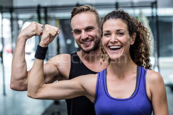 笑みを浮かべて 筋肉の カップル 上腕二頭筋 肖像 女性 ストックフォト © wavebreak_media