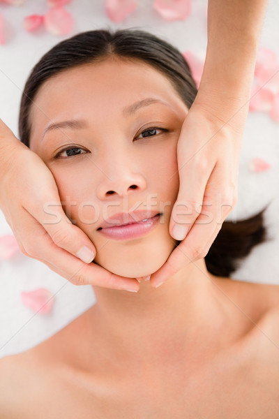 Stock photo: Attractive young woman receiving facial massage