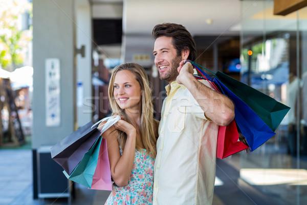 笑みを浮かべて カップル ショッピングバッグ 見える 遠く ストックフォト © wavebreak_media