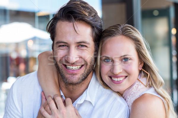 Smiling woman putting arm around her boyfriend Stock photo © wavebreak_media