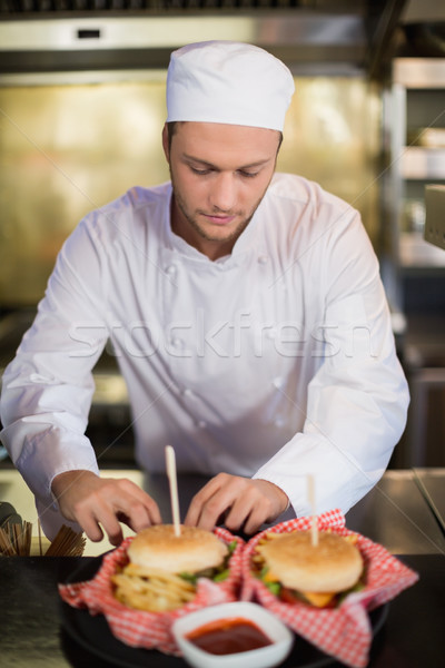Serious male chef preparing burger in commercial kitchen Stock photo © wavebreak_media