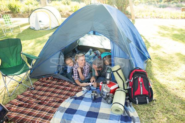 Familie naar camera tent camping meisje Stockfoto © wavebreak_media