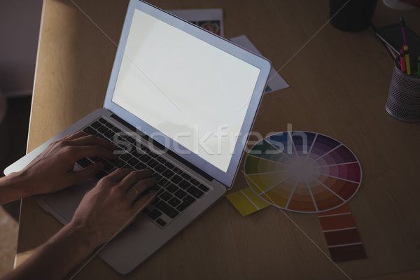 Entrepreneur typing on laptop at office desk Stock photo © wavebreak_media