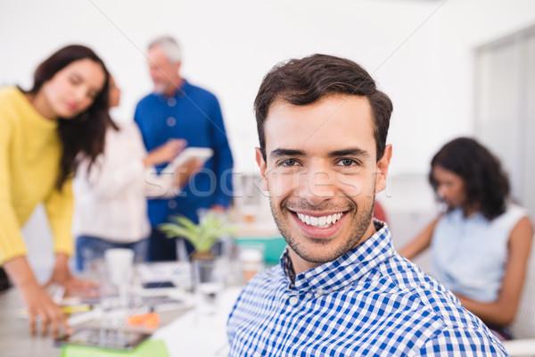 Retrato empresario colegas sonriendo oficina hombre Foto stock © wavebreak_media