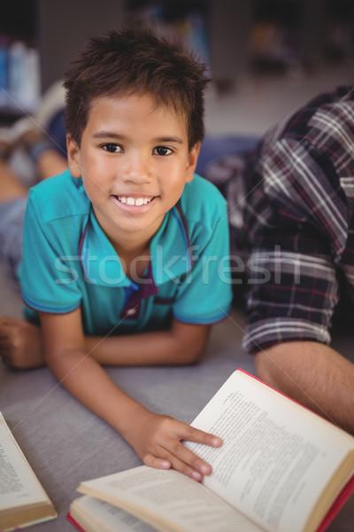 Portré boldog iskolás fiú olvas könyv könyvtár Stock fotó © wavebreak_media