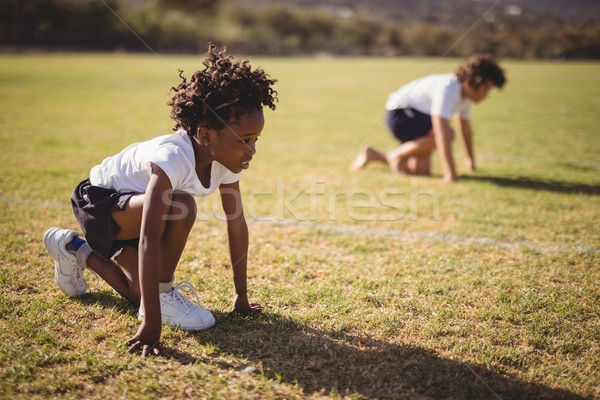 Schoolgirls in ready position during competition Stock photo © wavebreak_media