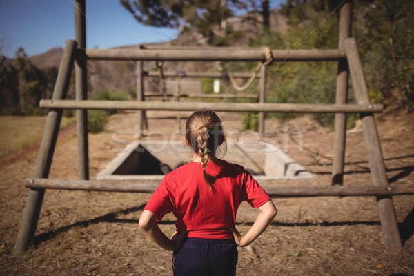 Rear view of girl looking at outdoor equipment during obstacle course Stock photo © wavebreak_media