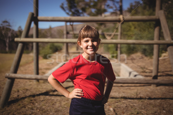 Portrait of happy girl standing with hands on hip during obstacle course Stock photo © wavebreak_media
