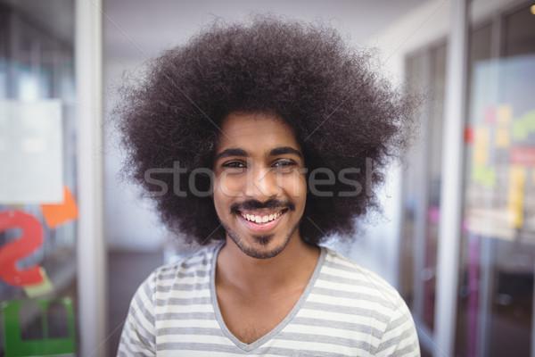 Portrait of smiling businessman with frizzy hair Stock photo © wavebreak_media