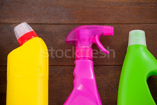 Detergent bottles and spray bottle arranged on a wooden floor Stock photo © wavebreak_media