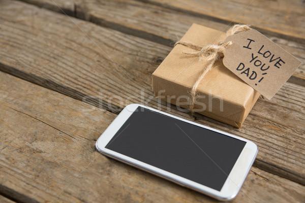 View cellulare scatola regalo tavola tavolo in legno Foto d'archivio © wavebreak_media