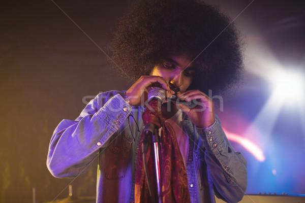 Male musician playing mouth organ in nightclub Stock photo © wavebreak_media
