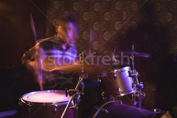 Bemozdult férfi dobos éjszakai klub előad zene Stock fotó © wavebreak_media