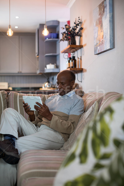 Senior man using tablet at home Stock photo © wavebreak_media