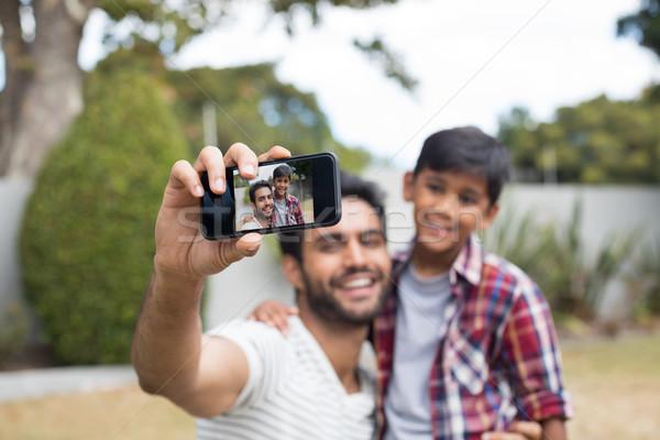 Gelukkig vader zoon praten familie telefoon kind Stockfoto © wavebreak_media
