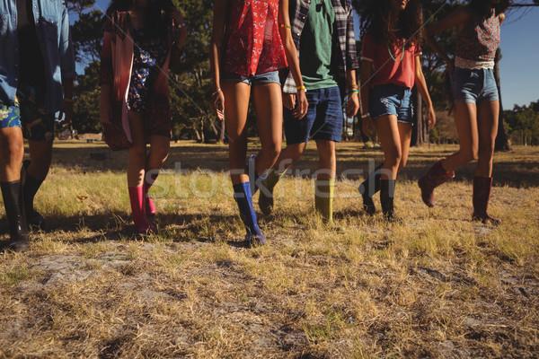 Low section of friends walking on field Stock photo © wavebreak_media