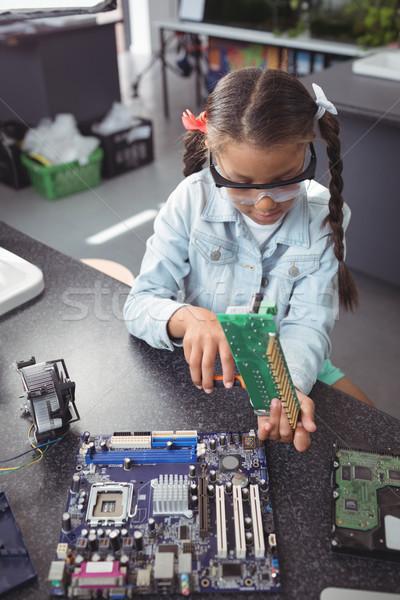 Elementary girl assembling circuit board on desk Stock photo © wavebreak_media