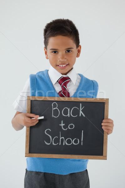 Schooljongen schrijven tekst terug naar school witte Stockfoto © wavebreak_media