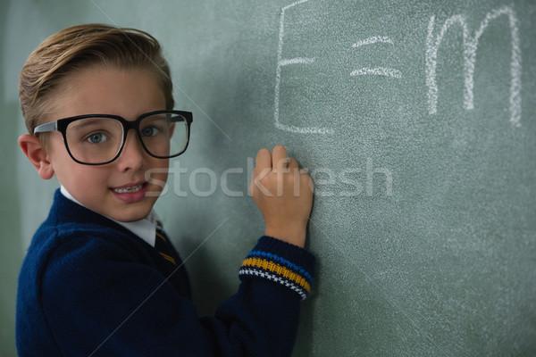 Iskolás fiú ír matematika képlet tábla portré Stock fotó © wavebreak_media
