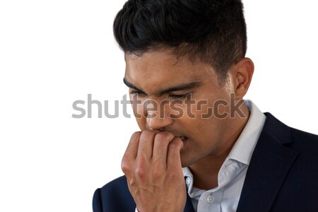 Close up of worried businessman biting nails Stock photo © wavebreak_media