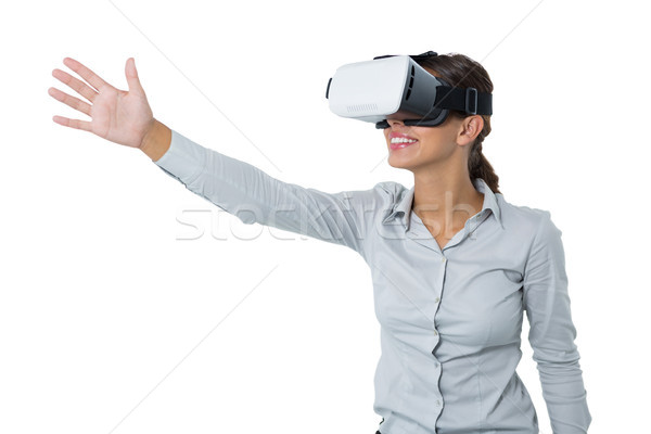Female executive using virtual reality headset Stock photo © wavebreak_media