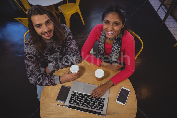 портрет друзей ноутбука кафе молодые таблице Сток-фото © wavebreak_media