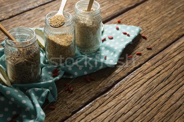 Három különböző magvak közelkép papír asztal Stock fotó © wavebreak_media
