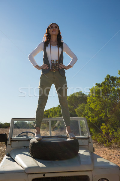 Full length of woman standing on off road vehicle with tire Stock photo © wavebreak_media