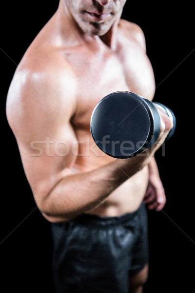 Midsection of shirtless man working out with dumbbell Stock photo © wavebreak_media