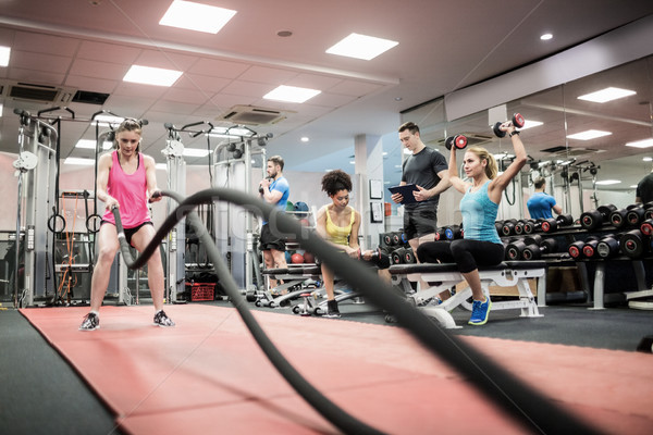Fit people working out in weights room Stock photo © wavebreak_media