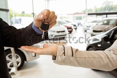 Close up of salesman giving a customer car keys Stock photo © wavebreak_media