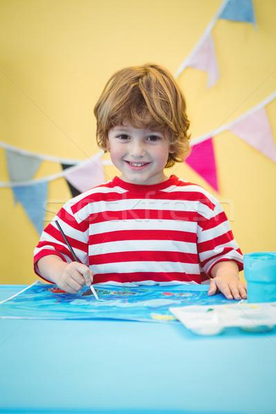 Sorridere ragazzo pittura foto desk carta Foto d'archivio © wavebreak_media