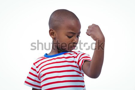 Boy looking his biceps Stock photo © wavebreak_media