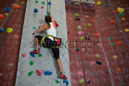 Low angle view of male athlete tying rope in health club Stock photo © wavebreak_media
