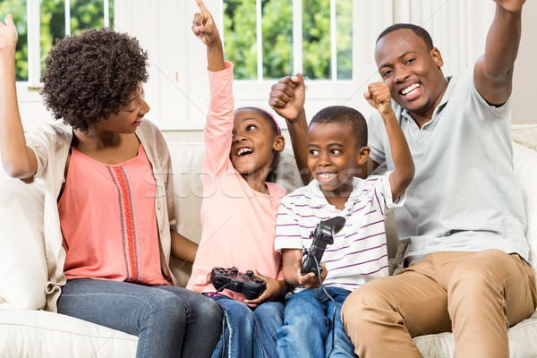 Smiling family sitting on the couch together Stock photo © wavebreak_media