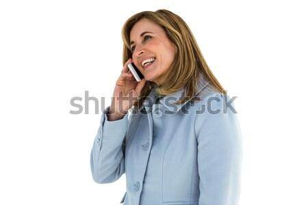 женщина улыбается женщину телефон телефон зеленый синий Сток-фото © wavebreak_media