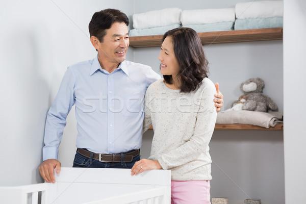 Happy couple near crib Stock photo © wavebreak_media