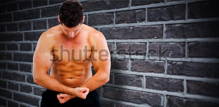 Portrait of fit man with hands on hips Stock photo © wavebreak_media