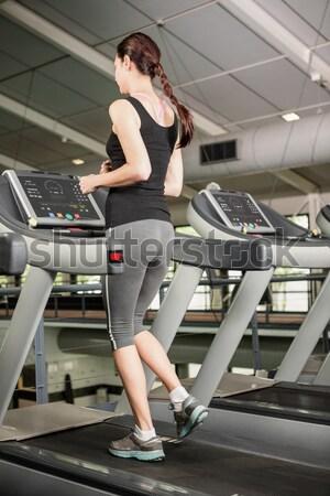 handsome man on treadmill drinking water Stock photo © wavebreak_media