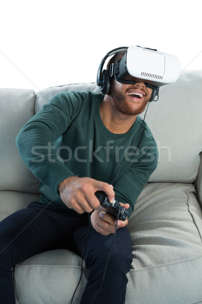 Man spelen video game virtueel realiteit hoofdtelefoon Stockfoto © wavebreak_media
