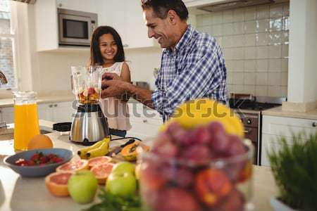 Couple having wine while chopping vegetables Stock photo © wavebreak_media