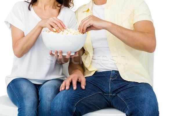 Uśmiechnięty para jedzenie popcorn biały kobieta Zdjęcia stock © wavebreak_media