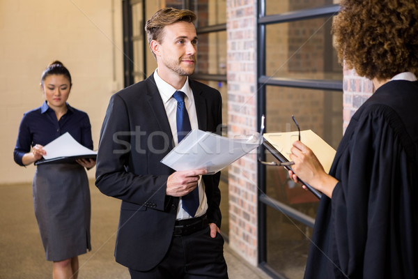 Lawyer looking at documents and interacting with businessman Stock photo © wavebreak_media